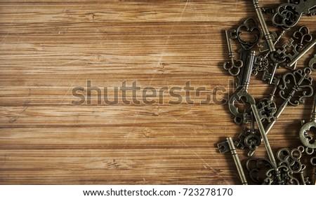 Vintage metal keys on the table #723278170