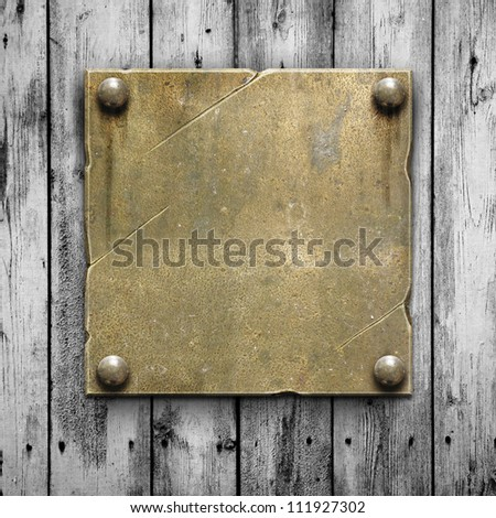 Vintage metal plate on old wooden planks