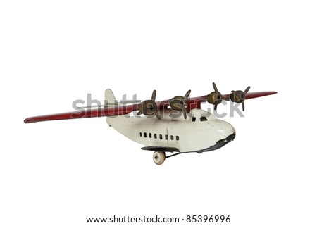 Vintage metal toy plane isolated on white.
