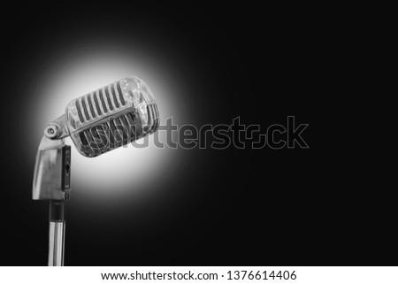 Vintage microphone on black #1376614406