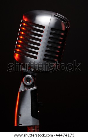 Vintage microphone on black with red highlights