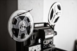 Vintage 8mm Projector Spools in Dark Room