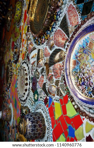 Vintage mosaic wall decoration by old bowls and plates Thai art #1140960776