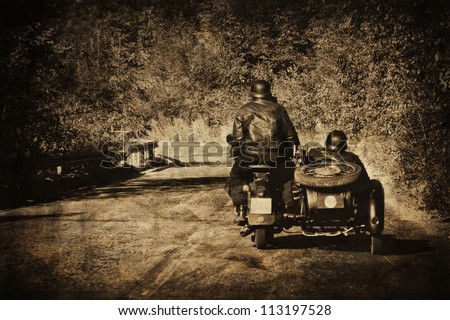 vintage moto biker in the road
