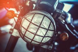 Vintage motorcycle headlight have bumper.