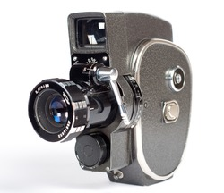 Vintage movie camera isolated on white