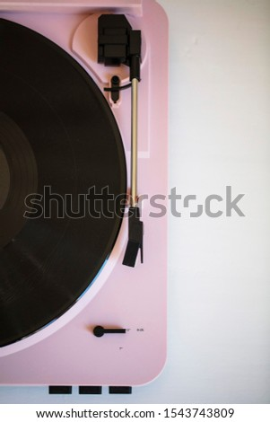 Vintage music record player with a vinyl record #1543743809