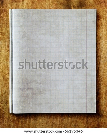 vintage note book on wood table