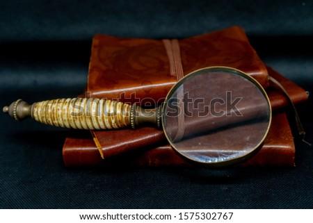 vintage notebooks and vintage magnifiyng glass #1575302767