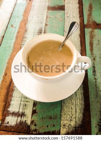 vintage of hot coffee on art table