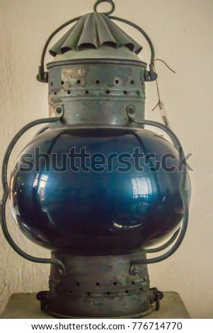 Vintage old blue submarine signal lamp, a visual signaling device for optical communication. #776714770