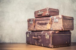 Vintage old classic travel leather suitcases circa 1940s. Travel luggage concept. Retro instagram style filtered photo