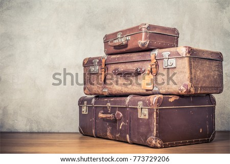 Vintage old classic travel leather suitcases circa 1940s. Travel luggage concept. Retro instagram style filtered photo #773729206