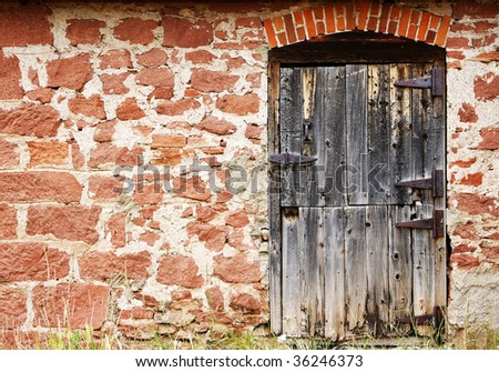 Vintage old door and wall of authentic 19th century architecture in a setting of the real American Old West.