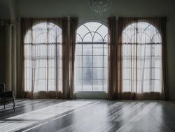 vintage old empty white studio room with big windows