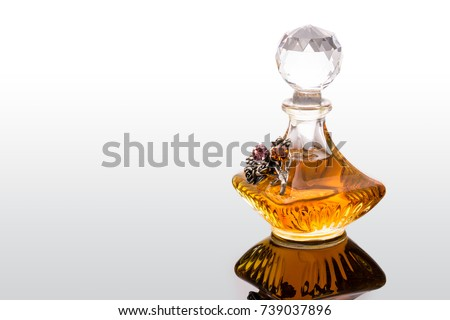 Vintage Old Fashion Glass Bottles Of Aromatic Arabic Oud Oils Perfume With Crystal Clear Ball Shape Dropper Isolated On White Background. Studio Shot Aromatherapy Concept. Blank Space For Text