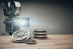 Vintage old movie camera and film cartridge on a wooden table 3D Render