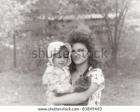 Vintage old photos of mom and daughter
