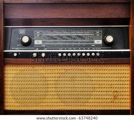Vintage old radio set grunge photo. Musical background