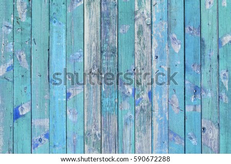 Vintage old shabby wooden fence from painted planks, rustic blue background