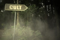 vintage old signboard with text cult near the sinister forest