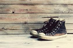 Vintage,old sneakers on wood