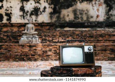 Vintage old television on stone brick with background wall ancient castle, classic tv style #1141874990