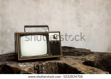 Vintage old television on the wooden with white wall background #1032834706