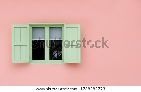 Vintage opened green mint shutters and wooden windows isolated on pink background with copy space and clipping path. Stock photo ©