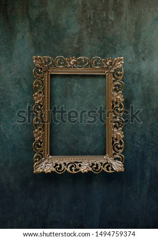 Vintage openwork bronze metal frame on a old wall background Photo stock ©