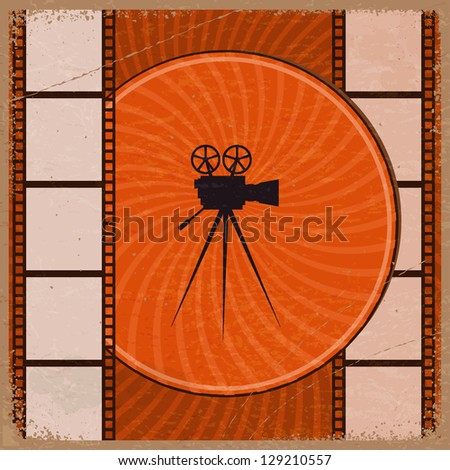 Vintage orange background with the silhouette of movie camera and film