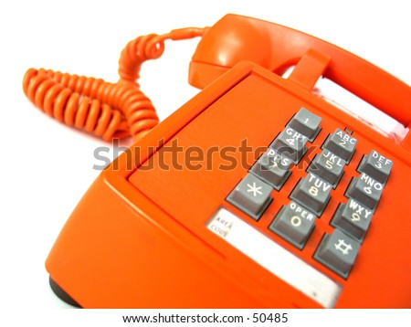 Vintage orange telephone. Focus on buttons.