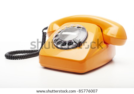 vintage orange telephone isolated over white background