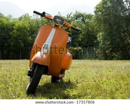 Vintage Orange Vespa - stock photo