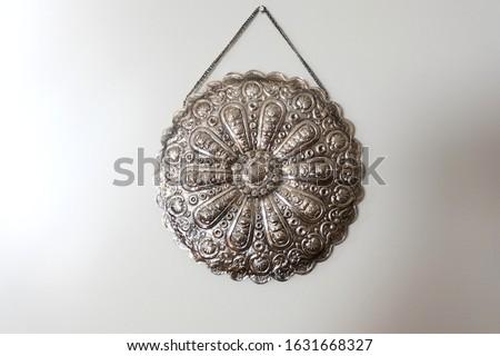 Vintage Ottoman Art Silver Art Mirror Back  Hanging on white wall Stok fotoğraf ©