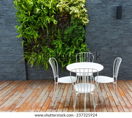 Vintage outdoor coffee table in cafe wooden terrace #237325924