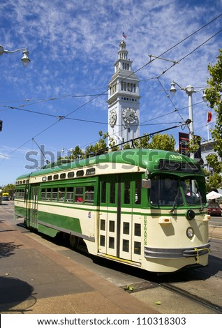 Vintage Overhead Cable Retro San Francisco Trolley Car moves through the street