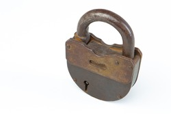 Vintage padlock. An old rusty key lock securely locking the door. Padlock on a white background. Collecting old things. Locking doors. Ancient padlock. Securing property. Close. Metal key lock.