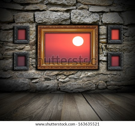 vintage painting frames like windows on wall and beautiful sunrise seen through ( the background in also a photo I made )