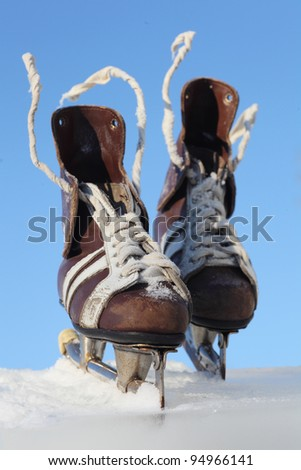 vintage pair of mens  skates on the ice