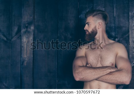 Vintage pampering lifestyle concept. Portrait of handsome attractive sexual strong neat groomed stylish trendy sporty sportive muscular brave powerful man isolated on wooden planks background #1070597672
