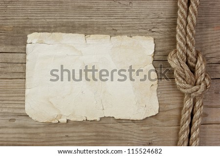 Vintage paper and rope on old wooden boards