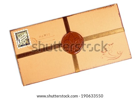 Vintage paper envelope with a golden ribbon and wax seal. Isolated on white background, saved with clipping path.
