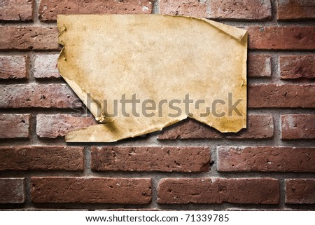 Vintage Paper on brick wall