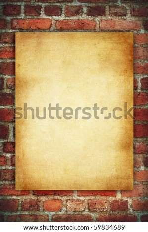 vintage paper on old red brick wall