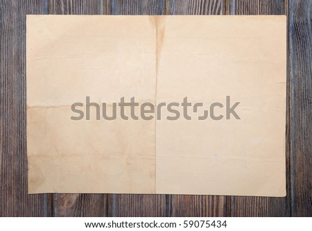 vintage paper over grunge pannel wood background