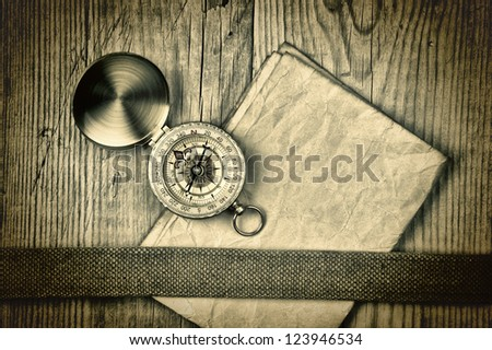 Vintage paper with compass  on old wooden boards