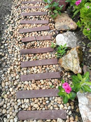 Vintage pathway, walkway.   Cobblestone,  rock stone and brick block as a footpath or track.