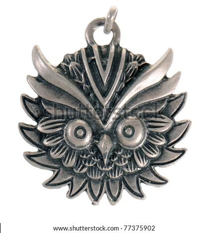 Vintage pendant shaped like an owl isolated on white background