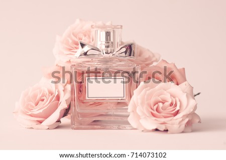 Vintage perfume bottle and roses